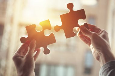 Businesswoman hand connecting jigsaw puzzle, Business solutions, success and strategy concept